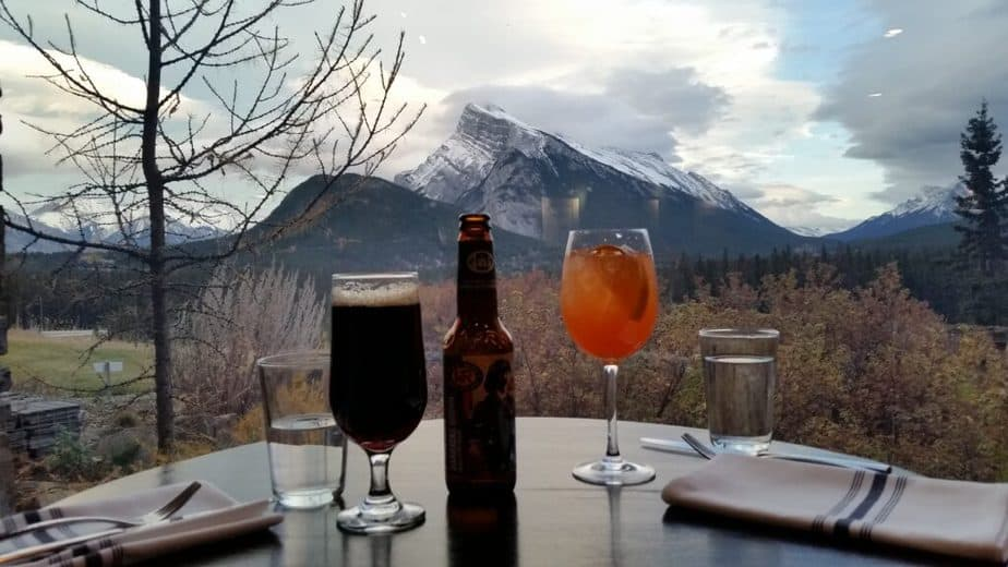 View of mountain range with beverages on a table in Banff