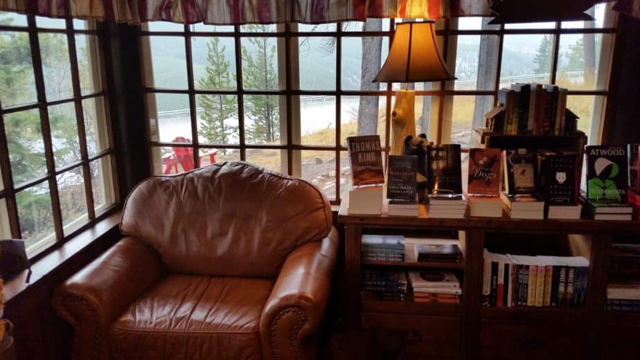 Cozy leather chair in a reading nook overlooking mountains in Lake Louise